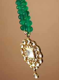 A Fine Piece of Pendent with Uncut Diamonds  Strung with Fine Emerald Beads