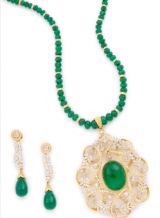 Diamond and Emerald Pendent Set strung with Emerald Chain and Diamond Rings.